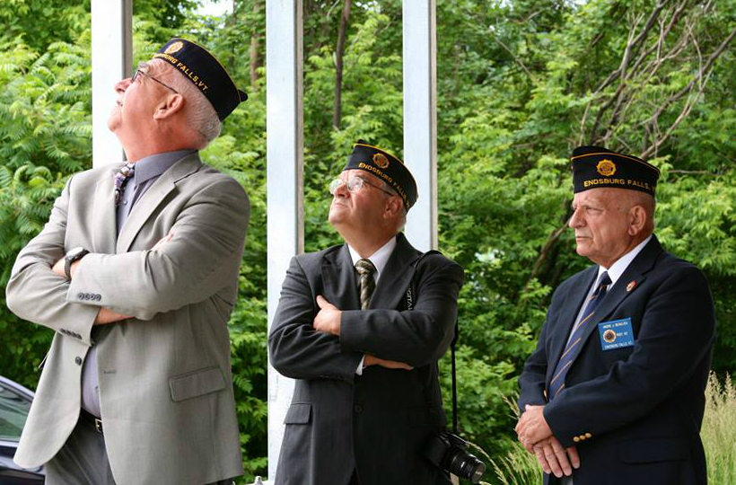Veterans look on