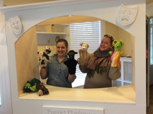 COTS representative testing out the new puppets and puppet playhouse!