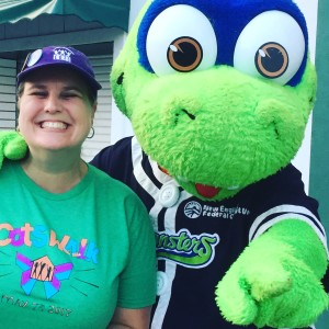 COTS Development & Communications Director Becky Holt with Lake Monsters Champ.